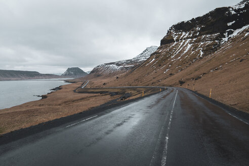 Iceland, empty wet coastal road - KKAF01017