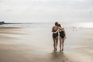 Mother and daughter heading to sea, Folkestone, UK - ISF05046