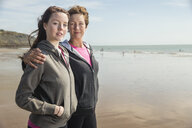 Mother and daughter on beach, Folkestone, UK - ISF05067