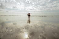 Mother and daughter heading to sea, Folkestone, UK - ISF05109