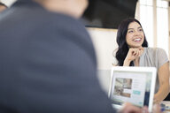 Over shoulder view of young businesswoman at office desk - ISF05148