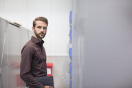 Portrait of young male supervisor in distribution warehouse - ISF05400