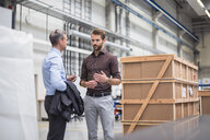 Manager and supervisor having meeting in distribution warehouse - ISF05406