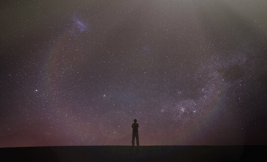 Silhouette of man looking away at starry night sky, Death Valley, California, United States, North America - ISF05631