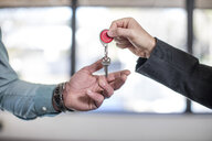 Estate agent handing keys to homebuyer, close-up - ISF05742