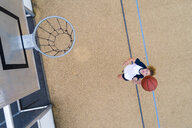 Young woman playing basketball, top view - STSF01582