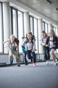Excited pupils rushing down school corridor - WESTF24188