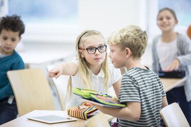 Serious girl rebuking boy in class - WESTF24206