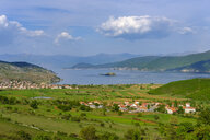 Albania, Prespa National Park, Lake Prespa with Maligrad Island and villages Lejthize and Liqenas, Greece and Macedonia in the background - SIEF07776