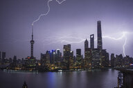 Elevated cityscape with lightning striking oriental pearl tower at night, Shanghai, China - ISF05900