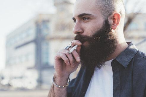 Bearded man smoking - ISF05921