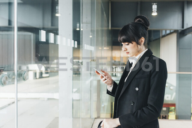 Businesswoman using mobile phone, Milan, Italy - ISF05963