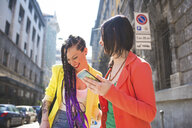 Women on city break using mobile phone, Milan, Italy - ISF06005
