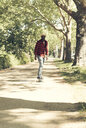 Cool young man skateboarding in park - UUF13843