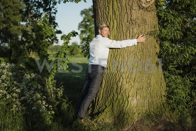 Man tree hugging - MOEF01197