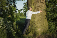 Man tree hugging - MOEF01197