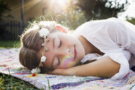 Girl with flowers round head sleeping - CUF13798