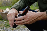 Man holding glass beer bottle, close up - CUF13807