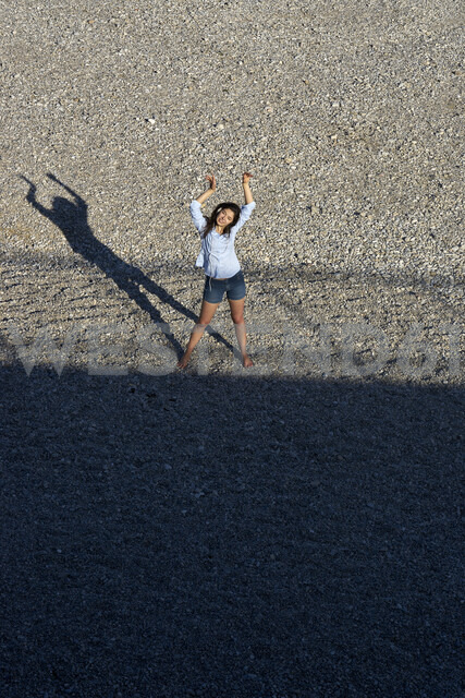 Dancing young woman with headphones seen from above - BEF00097