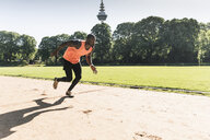Young athlete on sports field training running - UUF13888