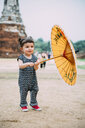 Thailand, Ayutthaya, Wat Chaiwatthanaram, portrait of toddler with yellow umbrella - GEMF02020