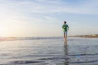 Man running along beach, Maspalomas, Gran Canaria, Canary Islands, Spain - CUF14365