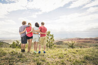 Rear view of teenage girl and adult friends looking out over landscape, Bridger, Montana, USA - CUF14524