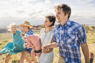 Young man and female friends walking in hills, Bridger, Montana, USA - CUF14557
