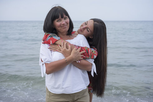 Greece, portrait of happy mother with her adult daughter in front of the sea - BEF00099