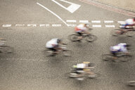 Overhead view of six cyclists speeding on urban road in racing cycle race - CUF14718