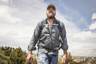 Low angle view of mature man hiking, Cody, Wyoming, USA - CUF15060