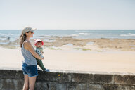France, mother and baby at beach promenade - GEMF02041