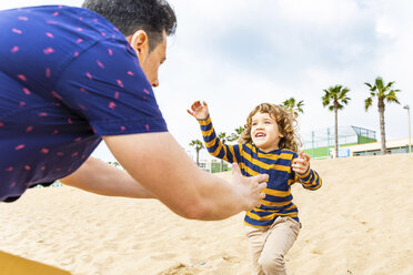 Spain, Barcelona, boy running toward his father on the beach - WPEF00363
