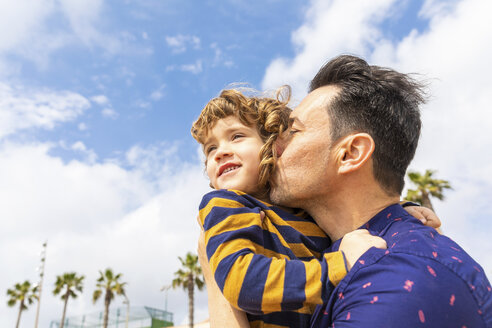 Spain, Barcelona, father kissing son on the beach - WPEF00375