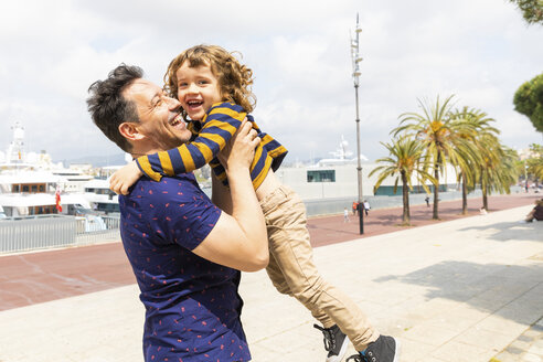 Spain, Barcelona, father and son playing together and having fun - WPEF00387