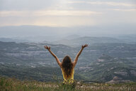 Spain, Barcelona, back view of happy young woman on Montcau Mountain - AFVF00547