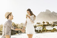 Man on one knee proposing to girlfriend on beach, Cape Town, South Africa - CUF15312