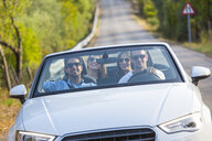 Four adult friends driving on rural road in convertible, Majorca, Spain - CUF16095