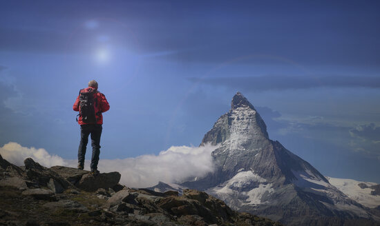 Rear view of senior male climber looking out at Matterhorn, Canton Wallis, Switzerland - CUF16293