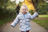 Happy female toddler running in autumn park - CUF16302