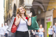 Young woman on shopping spree in town - CUF16563