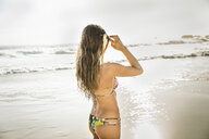 Mid adult woman wearing bikini looking out to sea, Cape Town, South Africa - CUF16977