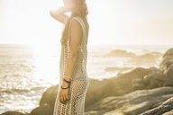 Mid adult woman looking out from sunlit beach, Cape Town, South Africa - CUF16998
