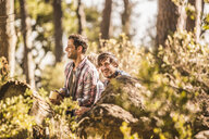 Two male hikers sitting drinking coffee in forest, Deer Park, Cape Town, South Africa - CUF17010