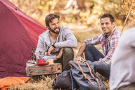 Men camping together in forest, Deer Park, Cape Town, South Africa - CUF17103