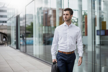 Young businessman in the city on the go - DIGF04527