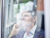 Portrait of mature businessman on cell phone - CVF00629