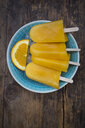 Home-made orange popsicles in bowl - LVF07008