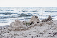 Germany, Ruegen, sandcastle on the beach - MJF02279