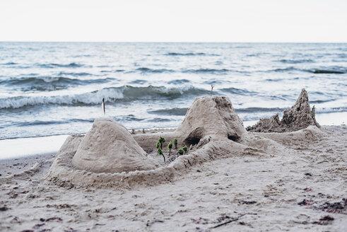 Germany, Ruegen, sandcastle on the beach - MJF02279